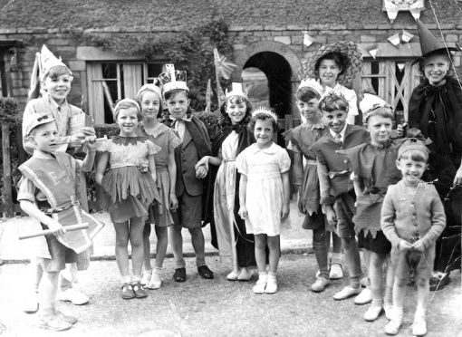 Black and white photo of cast of play written by me and Betty Chapman (the witch in the picture) and performed by children living on Albert Avenue for 1953 Coronation street party