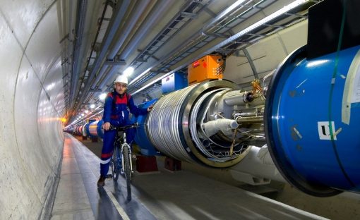 Photograph: inside the Large Hadron Collider with a man on a bike