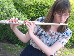 Holly playing her flute