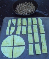 Buttered and sugared cake slices ready for the oven