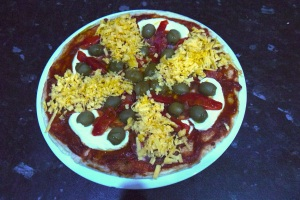 Simple pizza ready for the oven