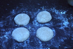 Dough made in the bread-maker is knocked back and shaped into four before leaving for the second rising