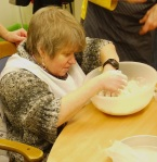 June gets the feeling of flour on her fingers