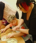 Lesley rolls her dough to make bread rolls
