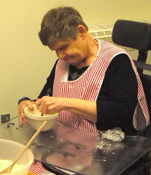 Pauline mixes yeast with water before adding to her dough