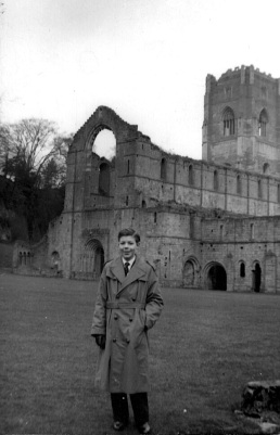 "1954, out with my grandmother for the day at Fountains Abbey (she took the photo). Now it will cost you £9.50 each to see this building; nothing then. She also bought the coat, several sizes too big so ""it would last"""