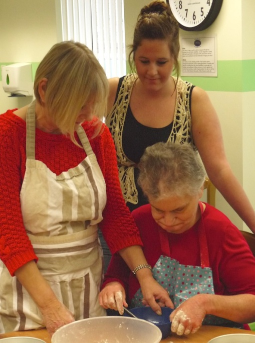 Picture of Wilberforce tenant Susan with two support workers