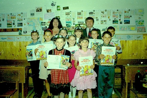 When I first suggested that I do an email project with the special needs class at School No.11, Suceava, the head said it was a waste of time as these children were incapable. He was gracious enough to admit he was wrong when the Bunnies invited him to see their end-of-project exhibition (on the wall behind them) and even wanted his photo taken with them. The other adult is the Bunnies' teacher, Vasilica. They are holding diplomas and prizes presented to them by the Leos