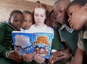 St Mary's Menston pupil Hannah Smith reads abut football to South African children