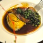 Braised lamb with minted peas and mash