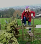Petronela climbing a stile on the way up to the pub