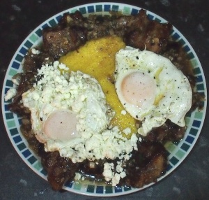 The finished tochitura, with mamaliga, fried eggs and cheese (Feta in the absence of Romanian fermented sheep's cheese).