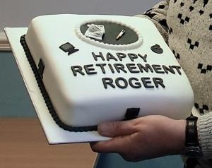 Retirement caked decorated with symbols of writing - paper, pen, computer monitor