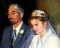 Bride and groom with marriage crowns during a Romanian wedding service