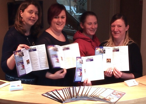 The team which has brought a new community magazine to my Wharfedale village, Menston.  L to R, Louise Atkinson, partner and graphic designer, Cathy Frobisher , Office Manager, Janet-Alison  Arkright , Partner and 'Sales Contributor', and   Andrea Kerman, Sales Person, at the reception in their offices in Haworth, each holding the first edition of the new magazine.