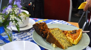 A plate with a slice of quiche, lemon drizzle cake and fruit cake in the 'pop-up' cafe in Malham Village Hall.
