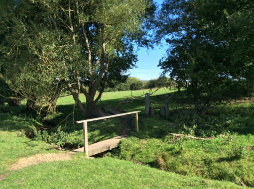 A simple 'plank' bridge over the stream (beck) which the footpath follows