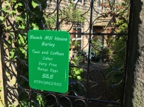 Sign on the gate from the public footpath into the Bleach Mill House garden - great home made cakes too!