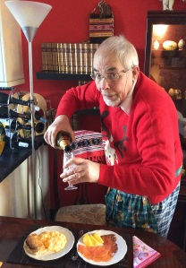 The author, Christmas morning 2016, with smoked salmon, scrambled eggs and champagne breakfast.