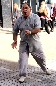 Picture of busker singing in Briggate, Leeds, today