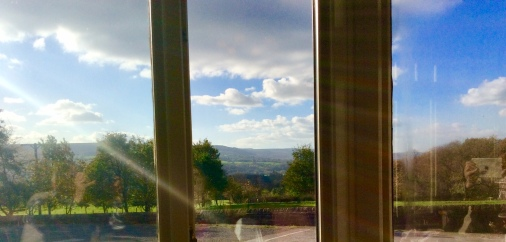 View through the windows of the deserted pub; we live under those hills on the other side of the river.