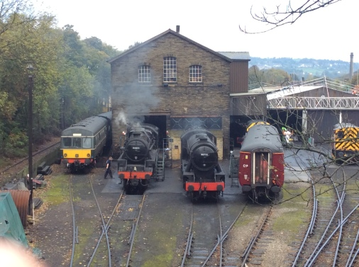 View of the engine shed at Haworth with two locomotives in steam.