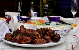 Barbecued mici on the table in the garden