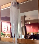 One of many ghosts, made of a mask and a thin white textile, hanging around the place