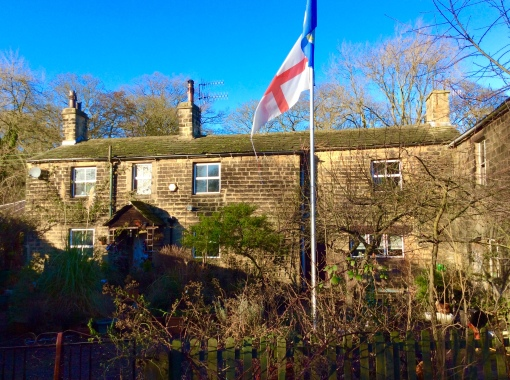 Bleachmill house with St George's and Yorkshire flags flying