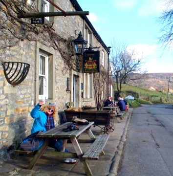 Cheers! Note the sign for fishing tickets. The Wharfe is one of the best fly fishing rivers in the country.