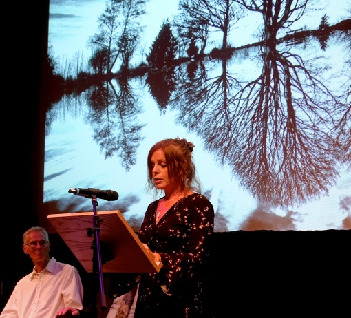 Jo telling a magical tale of childhood memories evoked by Bob's equally magical photo of the tarn, with reflections, on Ilkley moor