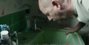 Still from the advertisement above showing the dad being sick