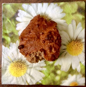 Photo of a small piece of the soda bread, on a floral paper napkin