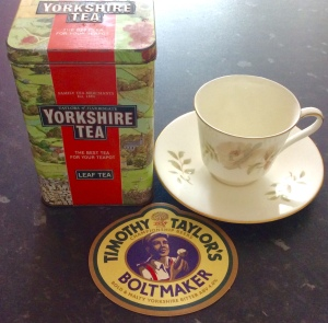 A Yorkshire tea tin, a beer mat from a Yorkshire brewery, Timothy Taylors in Keighly, and a Royal Doulton 'Yorkshire Rose' cup and saucer.