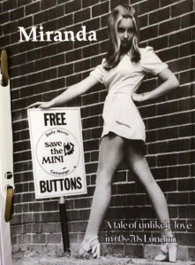 Working cover; photo of girl in mini dress holding a 'Save the mini' campaign poster